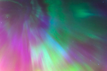 Polar lights Aurora Borealis in the night starry sky, texture and multi-colored natural phenomena.
