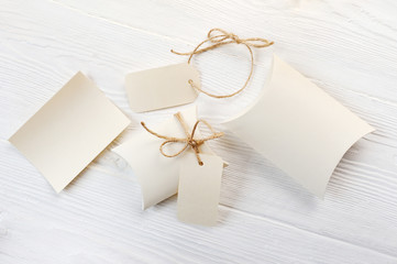 Mockup letter, boxes of bonbonniere and tag with place for your text on a white wooden background