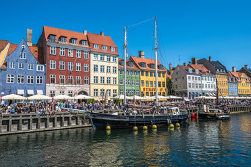 Nyhavn district is one of the most famous landmarks in Copenhagen, Denmark