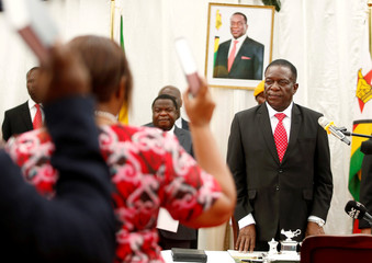 Zimbabwean President Emmerson Mnangagwa looks on at the swearing in of cabinet ministers at State House in Harare