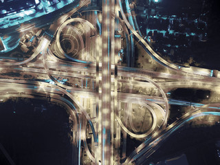 Expressway road intersect in city at night .