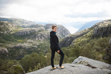 Woman on Top of Norway Mountain