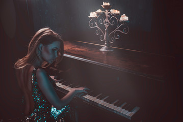 Beautiful woman with fancy elegant dress posing in the piano room