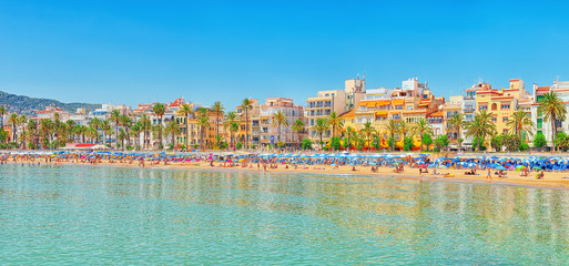 View of the beach and the sea shore of a small resort town Sitges in the suburbs of Barcelona. Spain.