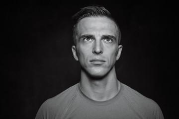 Fototapeta Portrait of bodybuilder shoor in studio on black background