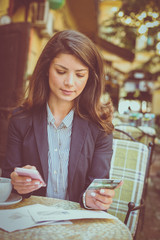 Check finances on smart phone app.