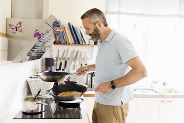 Smiling man cooking
