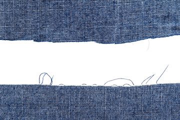 Pieces of dark blue jeans fabric