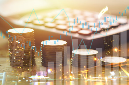 Finance, capital banking and investment concept, Double exporsure stacked of coins and night city with graph.