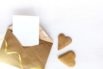 festive love message/ open letter with pure patterned blank and two gingerbread cookies in the shape of heart