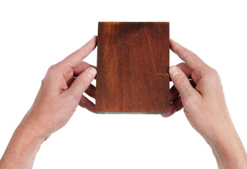 The old artist holds in his hands a wooden tablet  on which he will draw an icon of the Virgin Mary