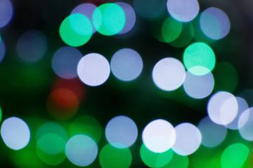 Bokeh of Christmas green decor lamps