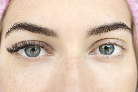 Young woman with eyelash extensions, closeup