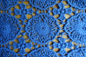 Tender blue lacy fabric on wood from above