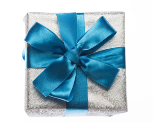 Gift box with ribbon on white
