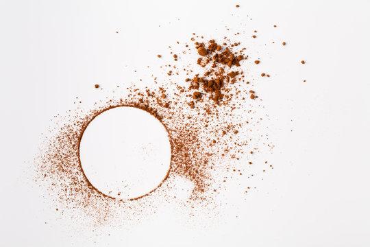 Many cocoa powder on white table