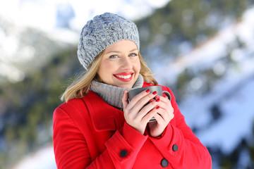 Happy woman posing in the mountain in winter