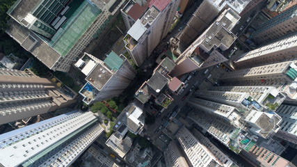 HongKong apartment building high narrow jangle concrete drone skyshot busy bild China people populations