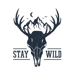 "Hand drawn inspirational label with mountains and deer skull textured vector illustrations and ""Stay wild"" lettering."