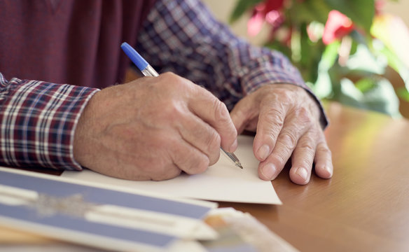 old man writing christmas cards