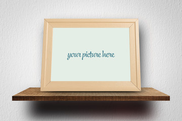 Empty wooden photo frame for mock up on white wall