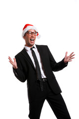 Photo of cheerful man in business suit, glasses, santa hat