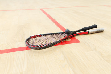 two squash rackets and ball
