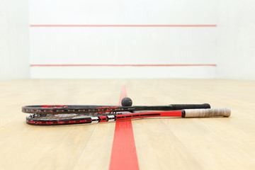 racquetball equipment and wall with red lines