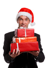 Christmas photo of happy man in business suit, Santa cap
