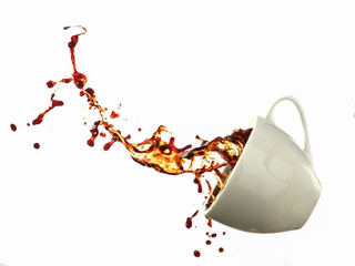 Coffee splashing from a cup isolated on white background