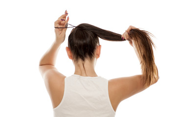 Back view of young woman tied her hair in ponytail