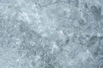 texture, background: cold shiny ice surface with cracks, patterns and bubbles, consisting of ice crystals
