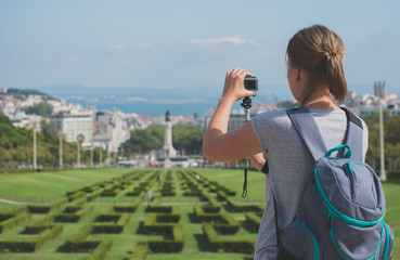 Woman tourist with camera in Eduardo VII Park in Lisbon.