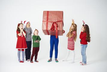 Shocked children looking at huge gift