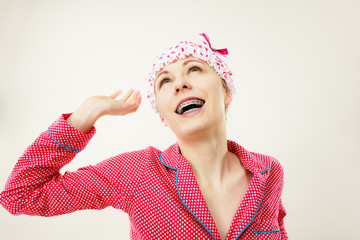 Funny woman wearing pajamas and bathing cap