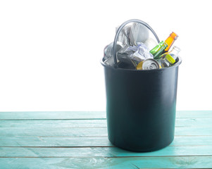 Recyclable garbage consisting of glass, plastic bottle, metal and paper in recycle bin, Ecology and recycle concept.