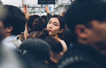 Poster de jardin Lieu connus d Asie Beautiful japanese woman in the metro station