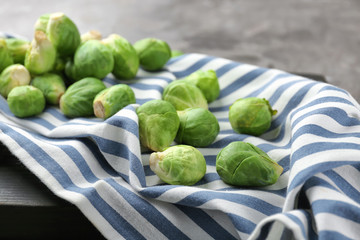 Fresh raw Brussels sprouts on striped cloth