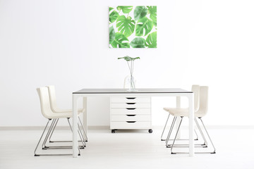 Modern office interior with big table and white chairs