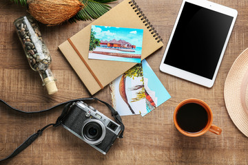 Composition with travel souvenirs on wooden background