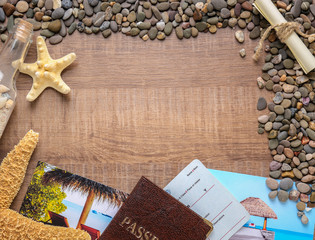 Composition with sea star, pebbles and passport on wooden background