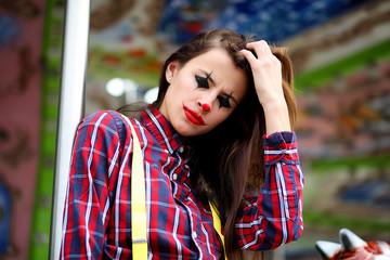 Cute girl in a clown makeup