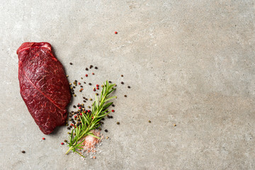 Raw beef steak with herbs and spices. Close up