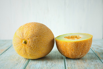 Yummy melon on wooden table