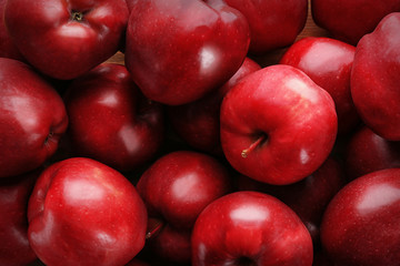Delicious red apples as background