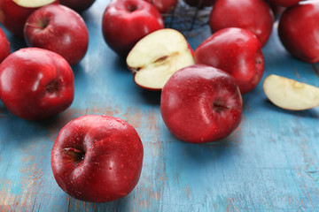 Delicious red apples on table