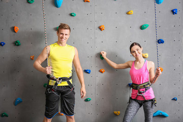 Young man and woman in climbing gym