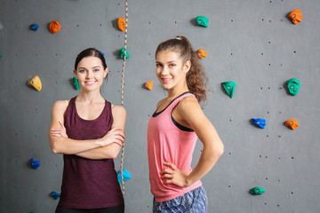 Young women in climbing gym