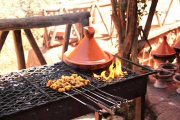 Cooking of meat in traditional Moroccan ceramic tajine dish, Morocco
