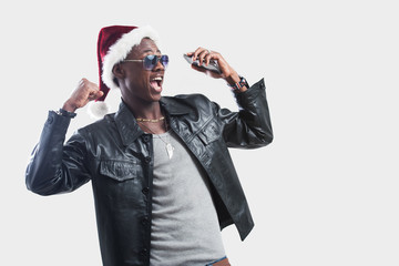 Young african man with Cell Phone at christmas time